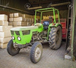 Tractor in steel structure storage shed